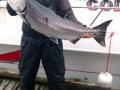 32lb-Tyee-Chinook-With-Fishing-Boat